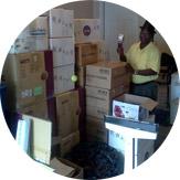 photo Meyer preparing shipment of donated items
