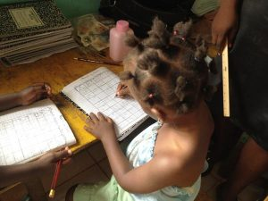 photo New Hope Childrens Village student working at desk