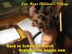 photo New Hope Children's Village child studying in school