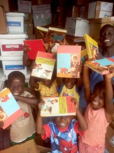 photo New Hope Children's Village Children receiving books