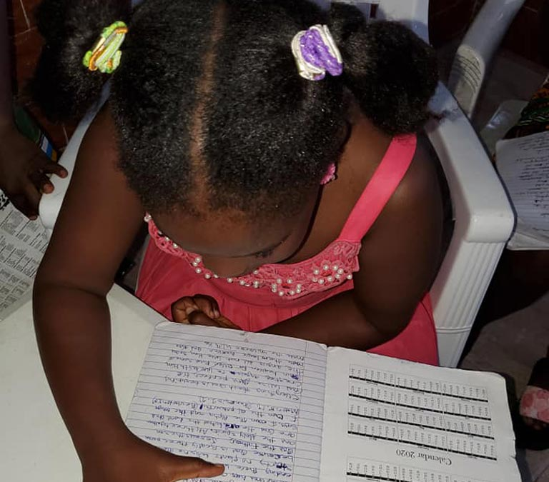 New Hope Children's Village Child Studying for School